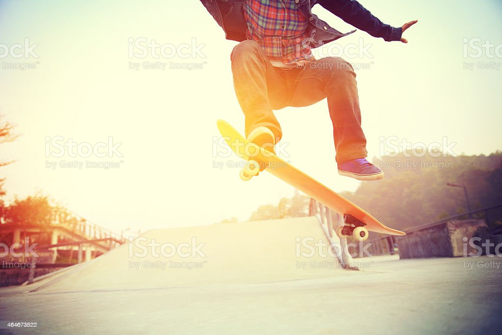 skateboarder jump at skatepark stock photo