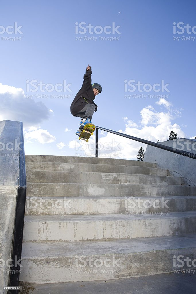 A skateboarder jumps a set of stairs. royalty-free stock photo