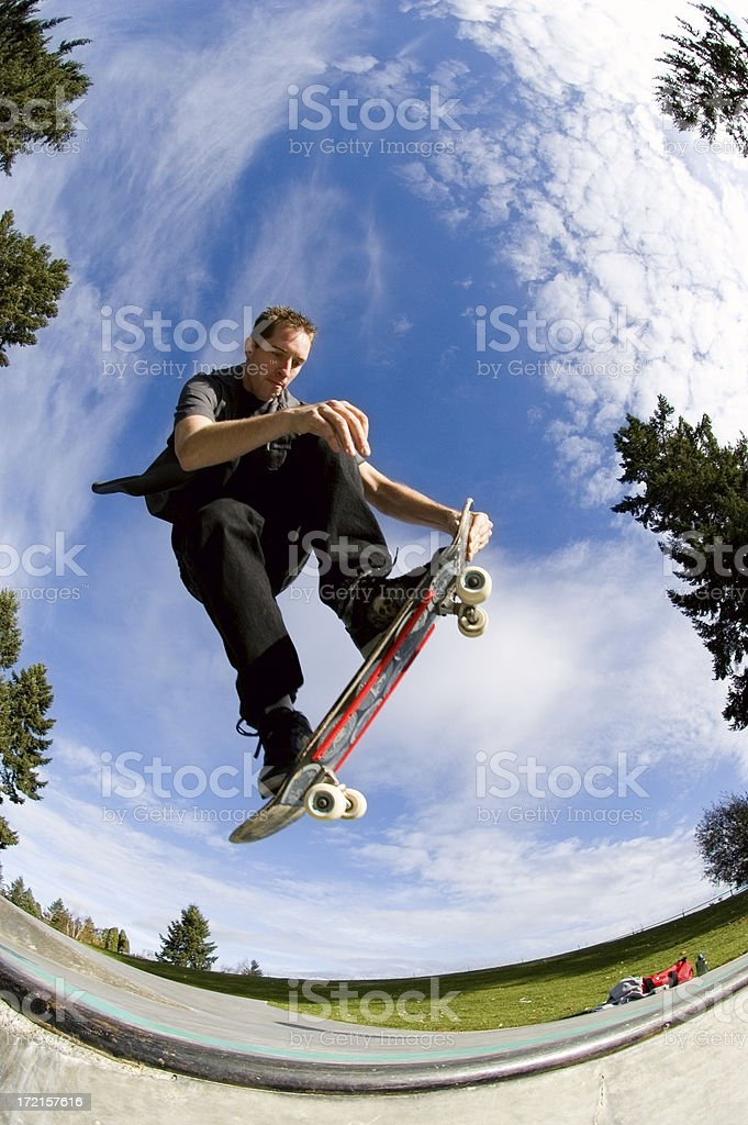 Skateboarder - Nose Grab Air stock photo