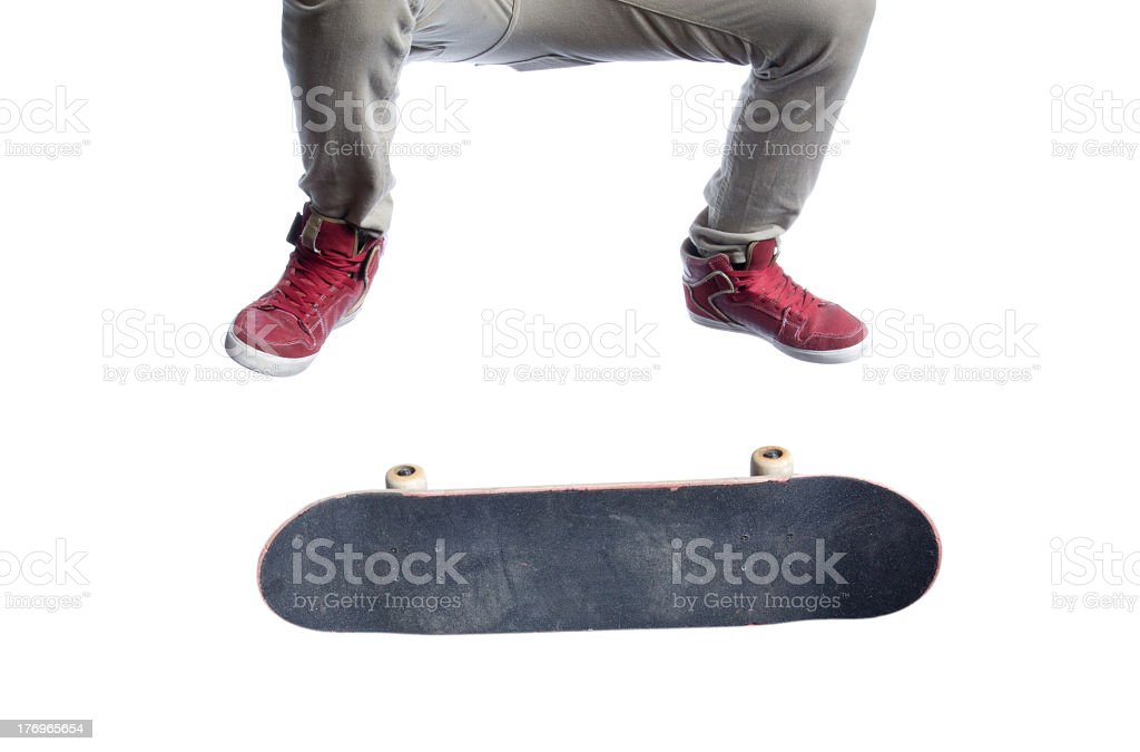 Skateboarder ollie kickflip in Hi-Top shoes Isolated on white stock photo
