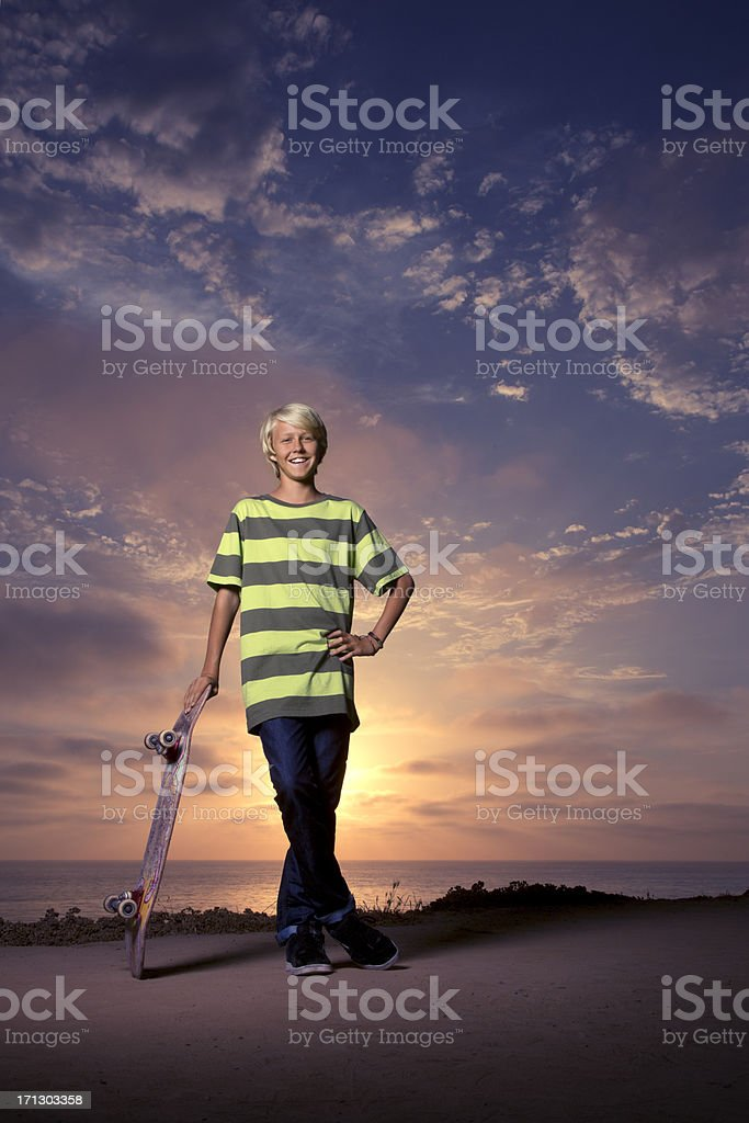 Skateboarder on a bluff by the Ocean in San Diego stock photo