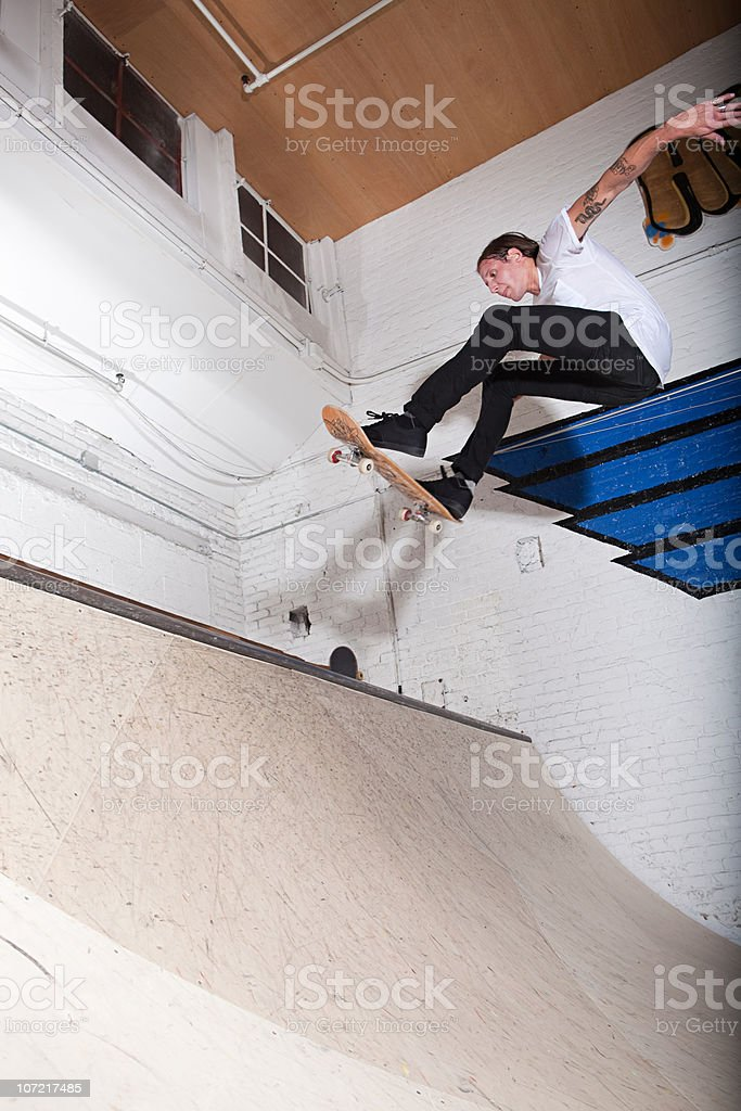 Skateboarder on ramp at skate park stock photo