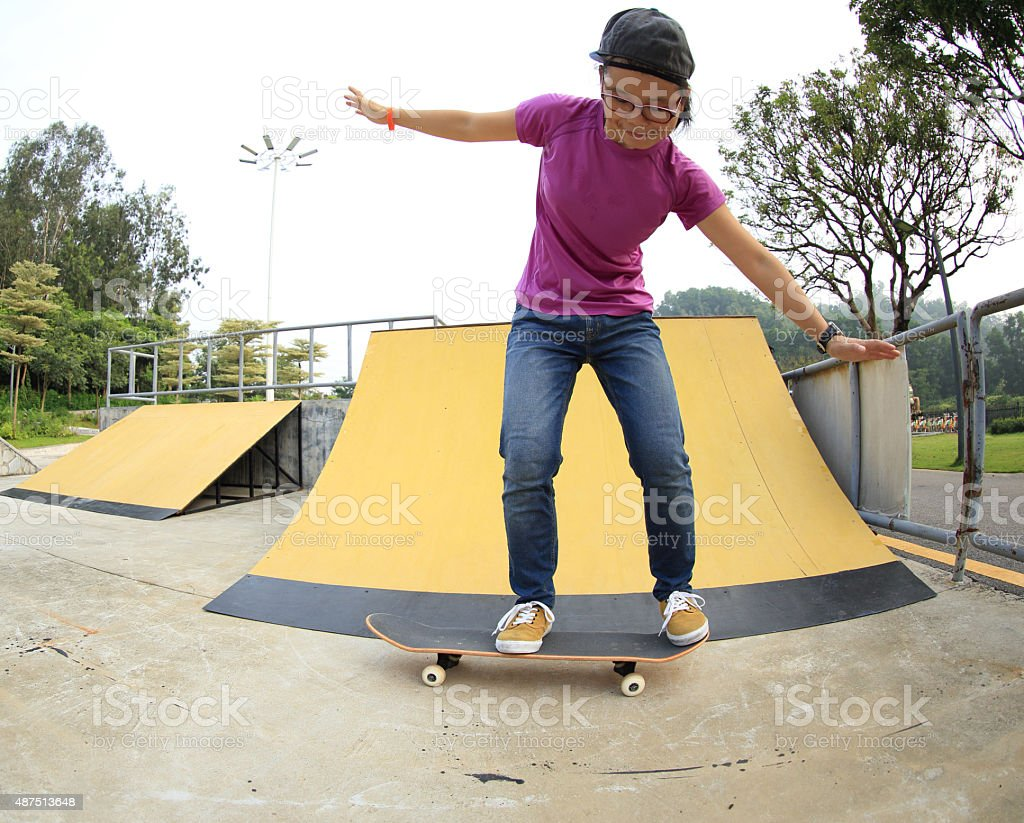 skateboarder prepare for a ollie jump at skatepark stock photo