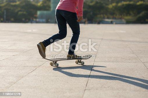 Skateboarder skateboarding at sunset city
