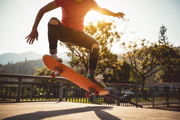 Skateboarder skateboarding on skate park stock photo