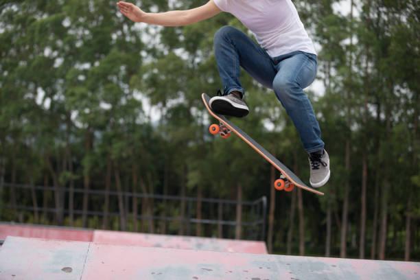 Skateboarder skateboarding on skatepark ramp stock photo