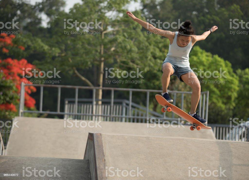 skateboarder skateboarding on skatepark ramp royalty-free stock photo