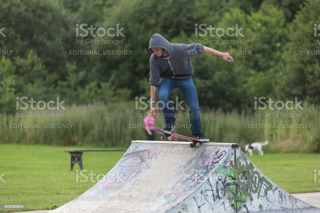 Skateboarder standing in Stake Park on funbox stock photo