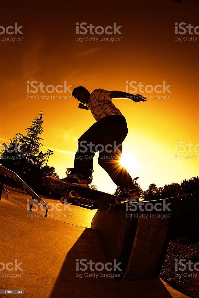 Skateboarder - Sunset Salad Grind royalty-free stock photo