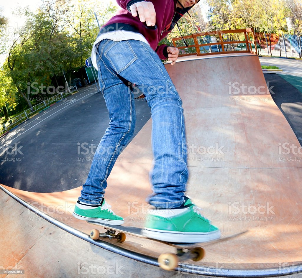 Skateboarder to jump the railing stock photo