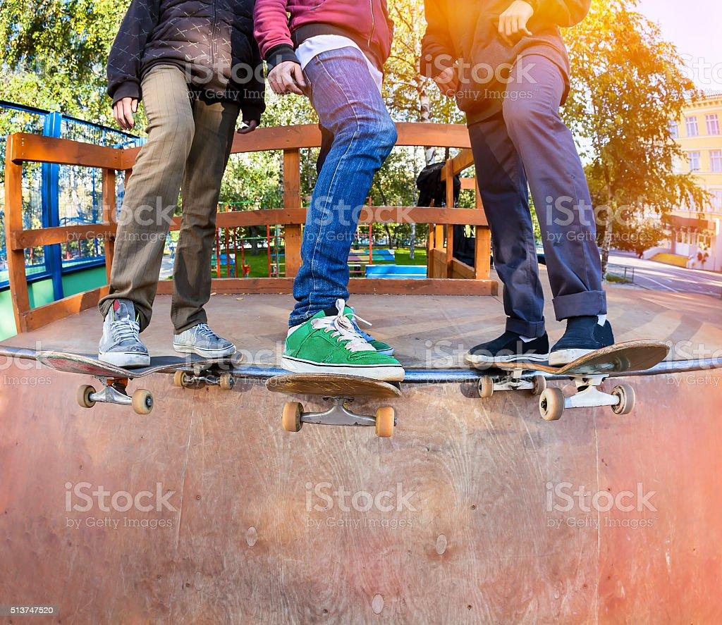 Skateboarders in skatepark stock photo
