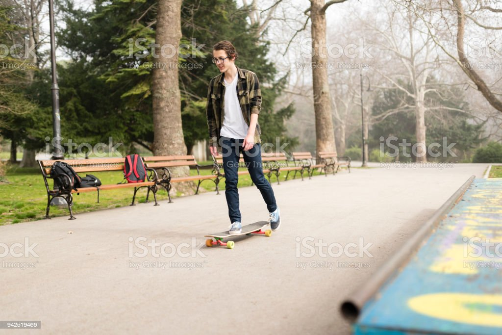Skateboarding after school stock photo