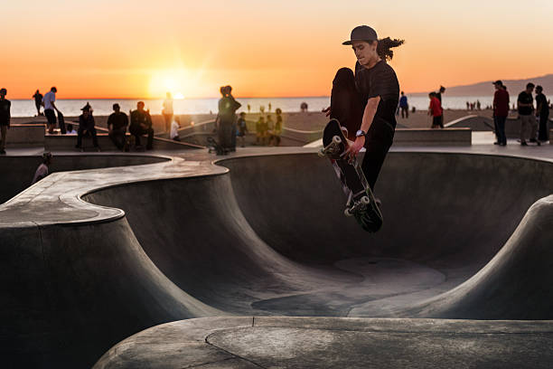 skateboarding at sunset - skateboarding stock pictures, royalty-free photos & images