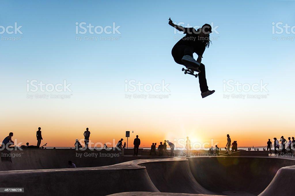 Skateboarding at Sunset stock photo