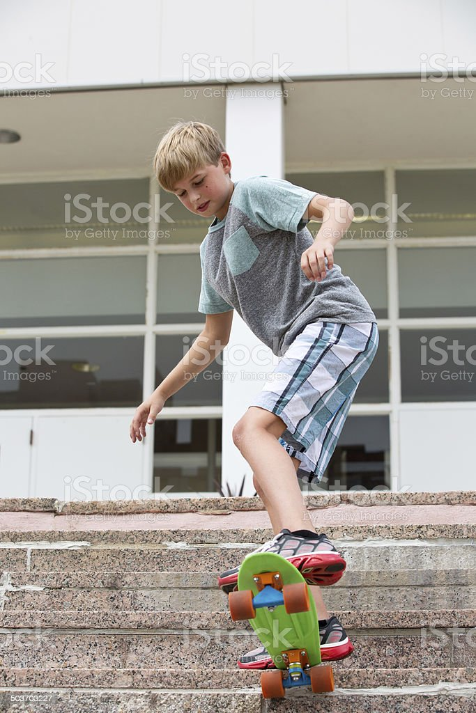 Skateboarding boy stock photo