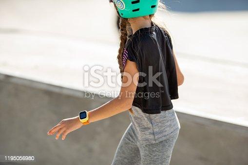 Skateboarding Girl Wearing Smart Watch While Riding.