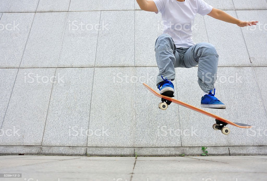 skateboarding jumping stock photo