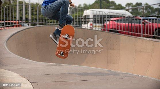 Skateboarding on skatepark ramp