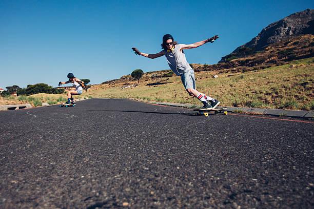 Skateboarding on the rural road. stock photo