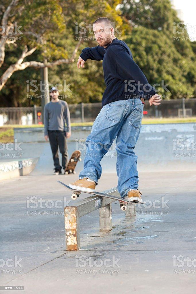 Skateboarding rail trick. stock photo