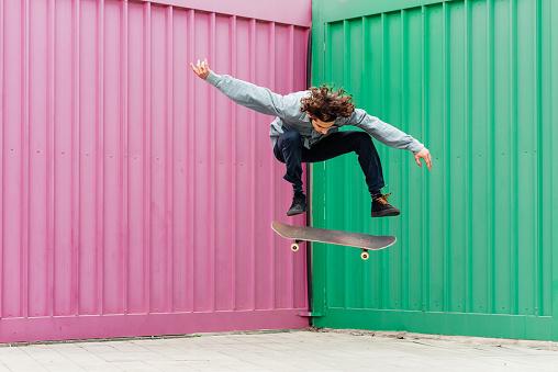 Young man skateboarding outdoors