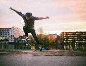 Skateboarding tricks in Berlin by the Spree river