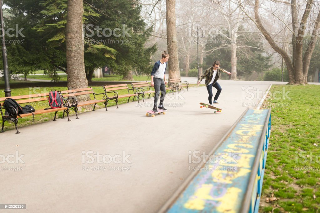 Skateboarding with friends after school stock photo