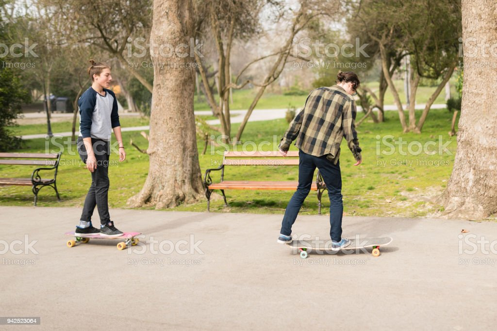 Skateboarding with friends stock photo