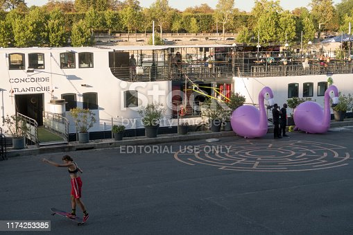 Paris, France - Aug 30, 2019: Young Femael Skater at the Concorde Atlantique boat at the bank of the  Seine River, Paris , France.