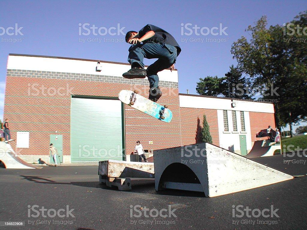 Skater doing a Kickflip stock photo
