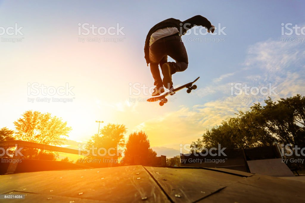 Skater doing a stunt stock photo