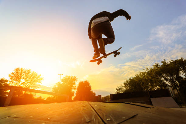 skater doing a stunt - skateboarding stock pictures, royalty-free photos & images