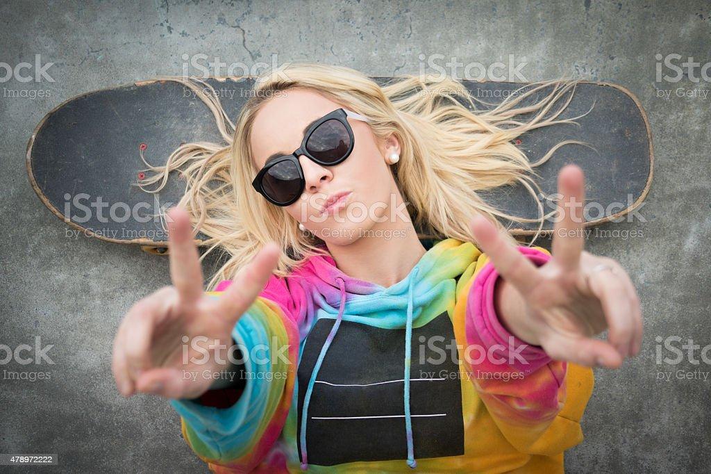 Skater Girl Peace Sign stock photo