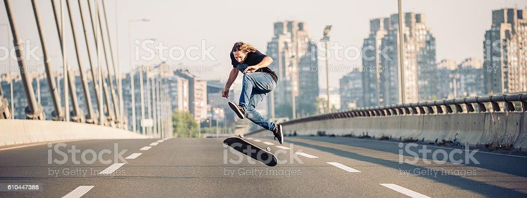 Skater jumping on the street highway bridge. Panorama view stock photo