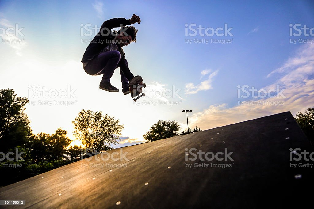 Skater jumping stock photo