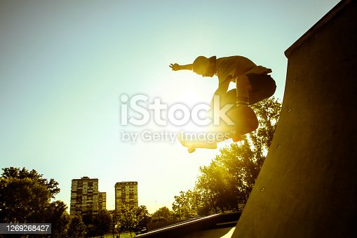 Young man skateboarding in a skate park. About 25 years old, Caucasian male.