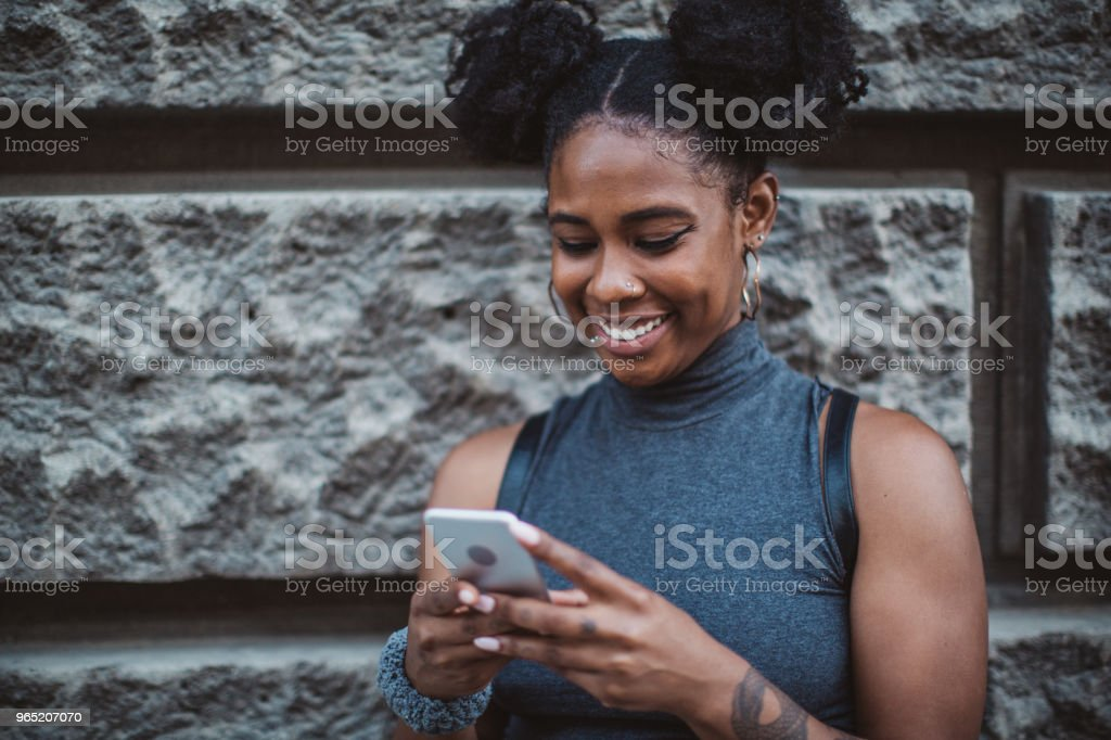 Skater using phone on street royalty-free stock photo