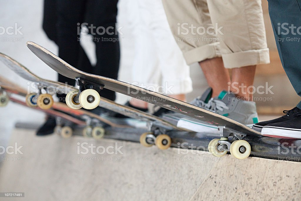Skaters and their boards stock photo