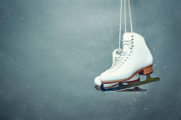 Skaters skaters are suspended on the background Figure skates are suspended against the background ice skating stock pictures, royalty-free photos & images