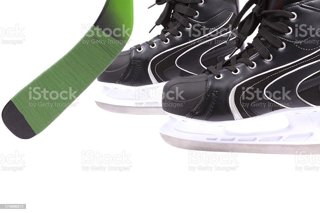 skates and hockey stick royalty-free stock photo
