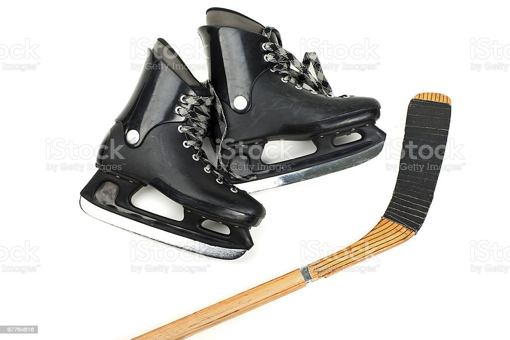 Skates and stick royalty-free stock photo