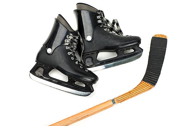 skates and stick - hockey stick stock pictures, royalty-free photos & images