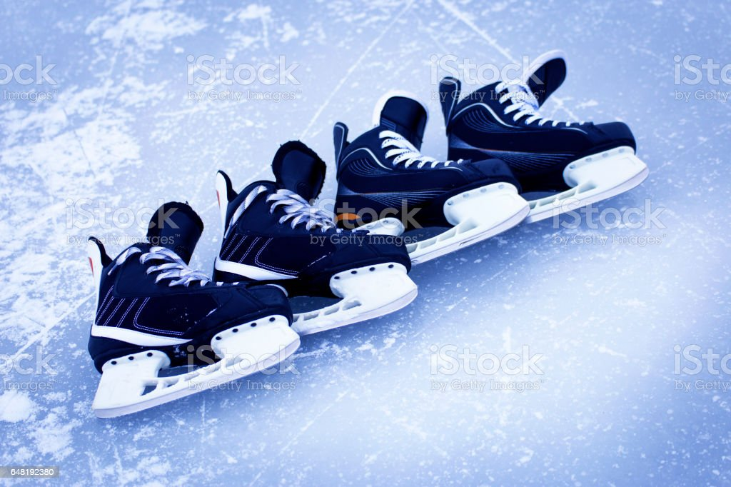 Skates for hockey on the outdoor ice winter. stock photo