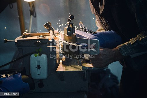 Figure ice skate getting sharpened on a machine
