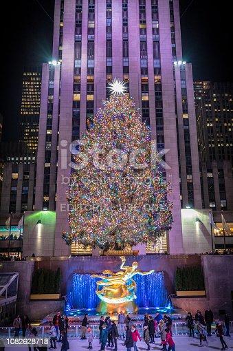 New York City - December 12, 2018, ice skaters underneath the Rockefeller Christmas tree
