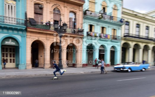Cuban teenage boy skating on street of Padeo de Marti in Old Havana, Cuba