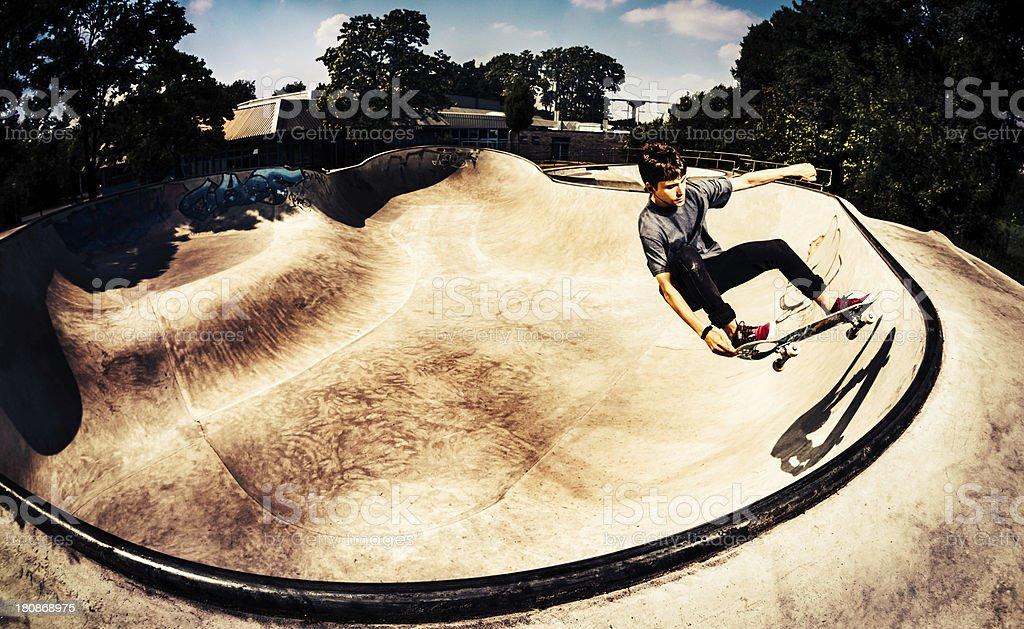 Skating in the half pipe stock photo