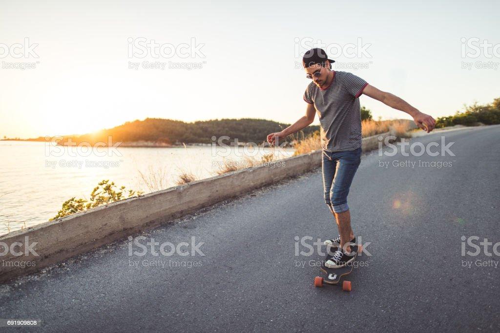 Skating near the sea stock photo