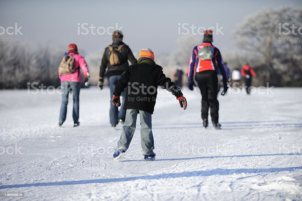 Skating people on a lake in the Netherlands royalty-free stock photo