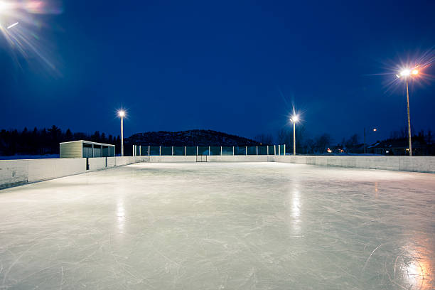 skating rink Outdoor skating rink at night in quebec  ice rink stock pictures, royalty-free photos & images